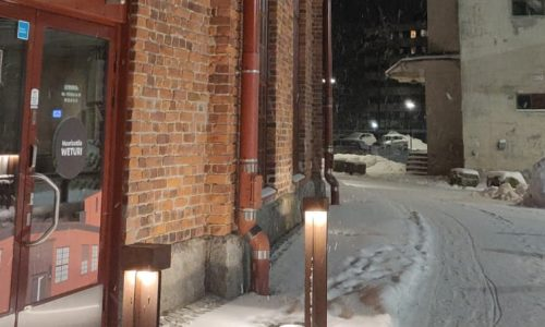 Kuvassa nuorisotila weturin ulko-ovi. Taustalla Viljasiilot. Ruskean tiilirakennuksen sivu vasemmalla puolella, oikealla harmaan betonirakennuksen sivusta.